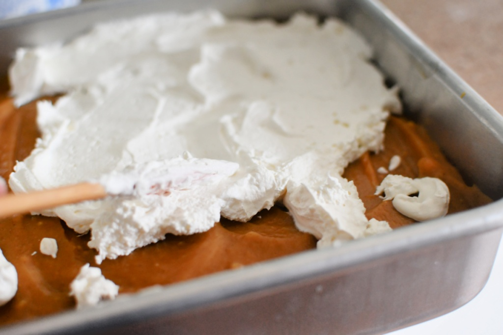 adding whipped topping to dessert