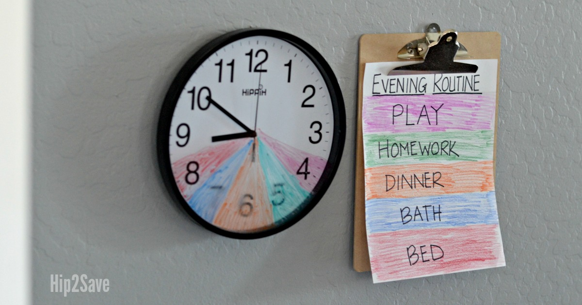 DIY kids routine clock next to a schedule on the wall