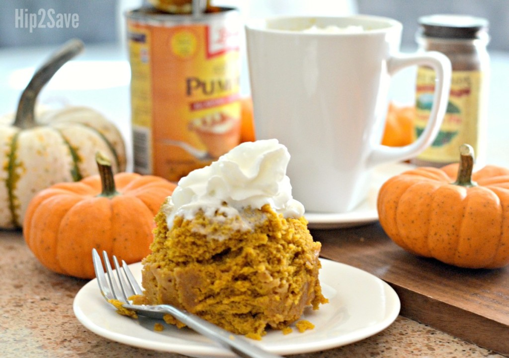 pumpkin cake topped with whipped cream