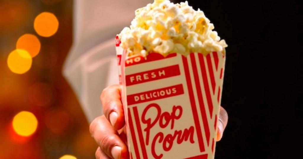 holding small popcorn