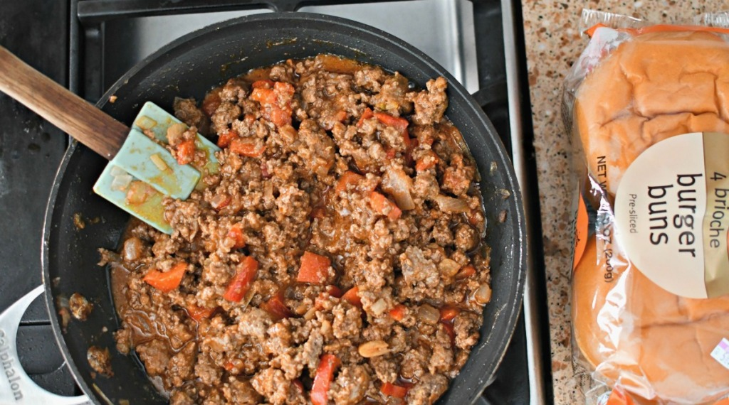 skillet with sloppy joes and buns