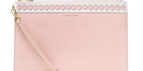 Macy's.com: 20% Off Select Handbags = Michael Kors Extra Large Clutch Just $41.40 (Reg. $169)