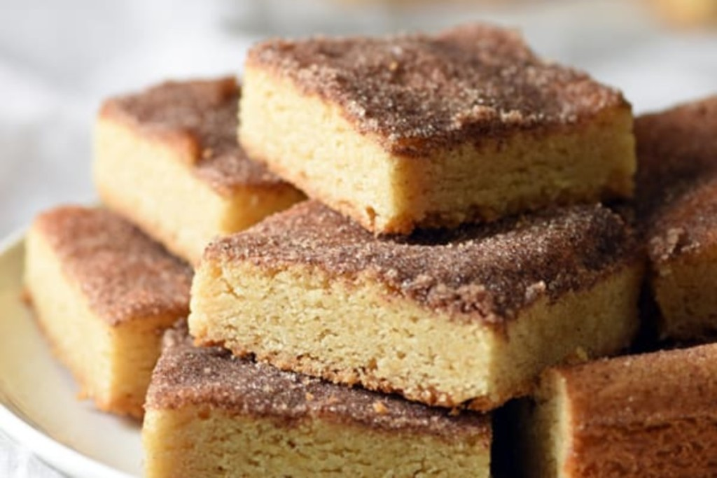 snickerdoodle bars stacked on plate