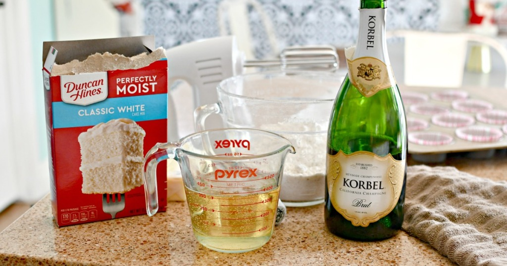 cake mix and champagne on the counter for cupcakes