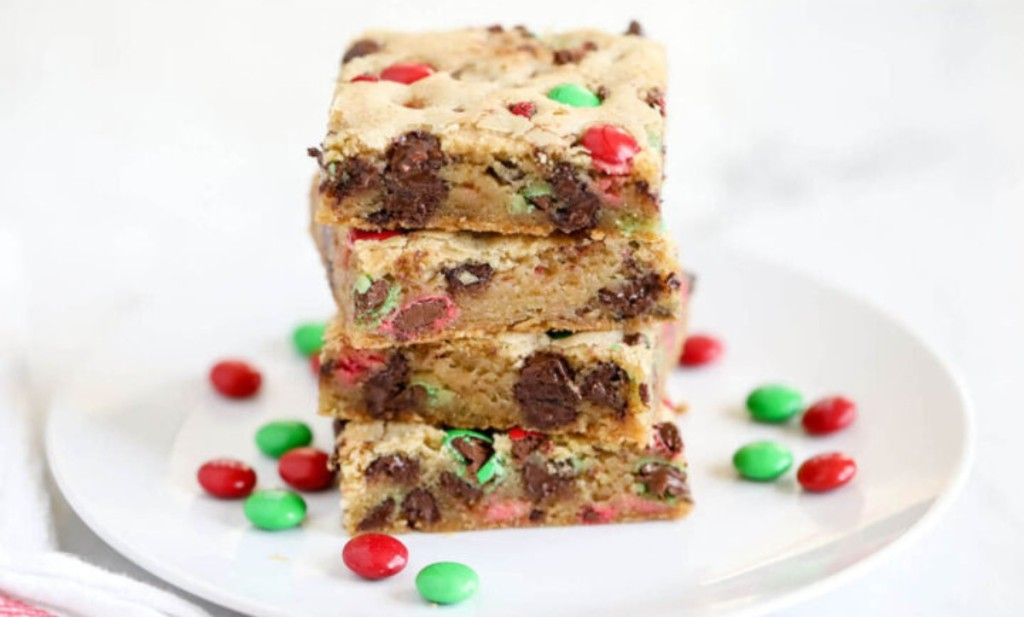 M&Ms cookie bars stacked on a white plate