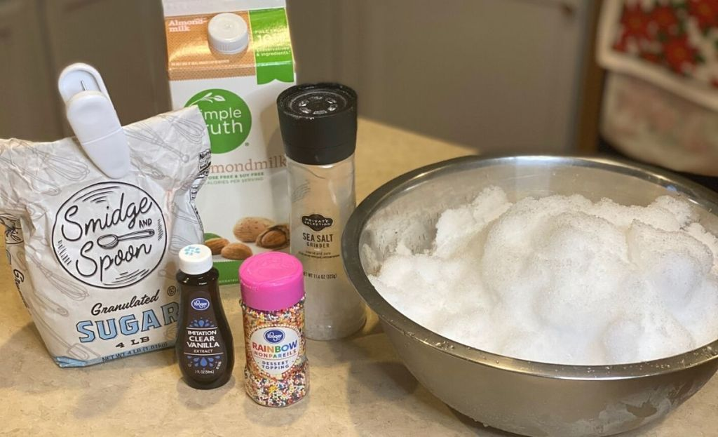 Ingredients to make ice cream with snow on a counter