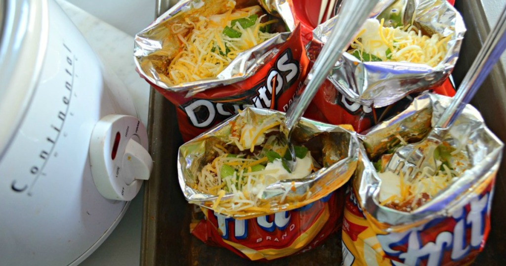bags of fritos with taco toppings for walking tacos