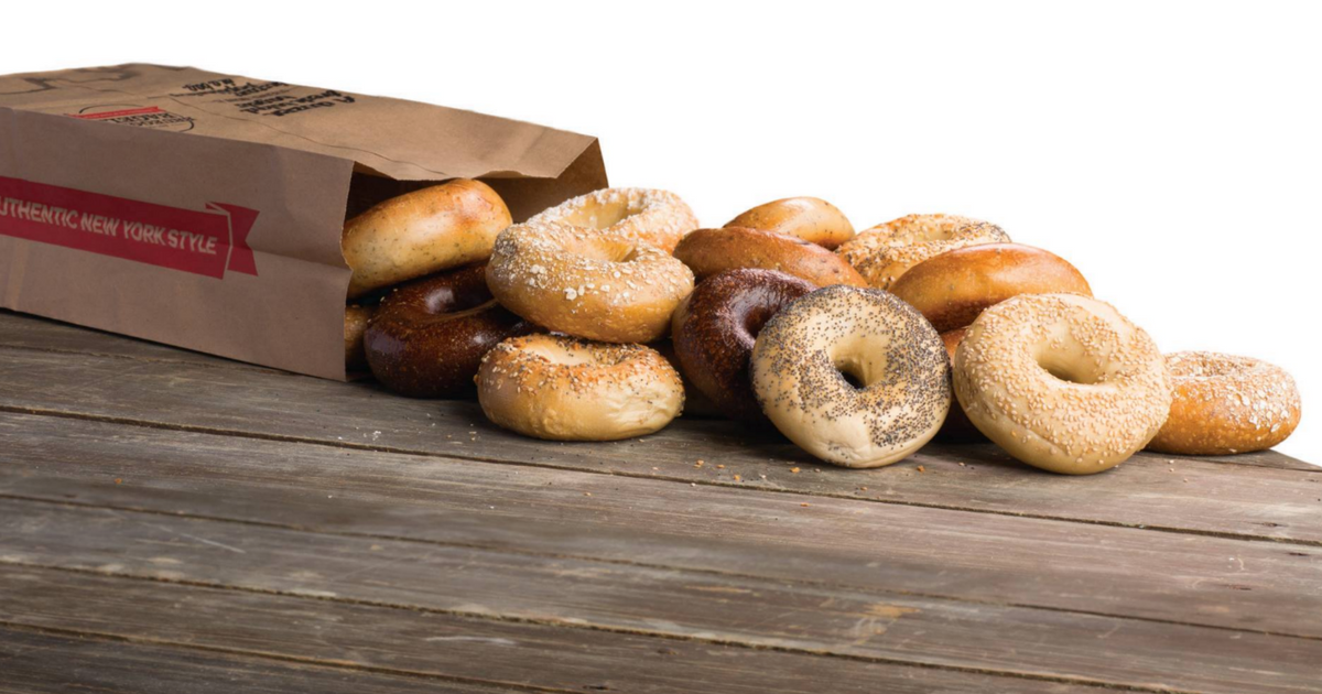 Brueggers Bagels spilling out of a brown paper sack