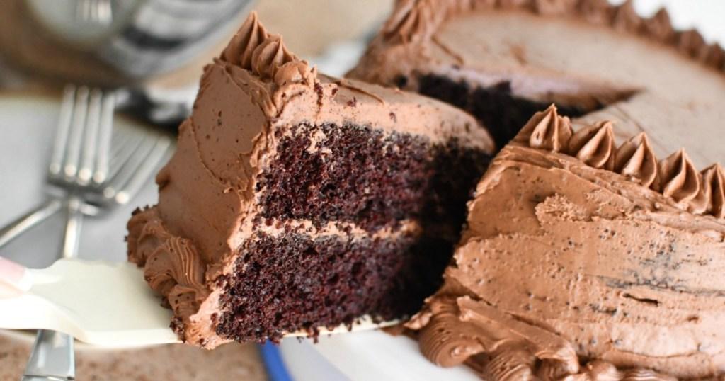 taking slice of chocolate cake