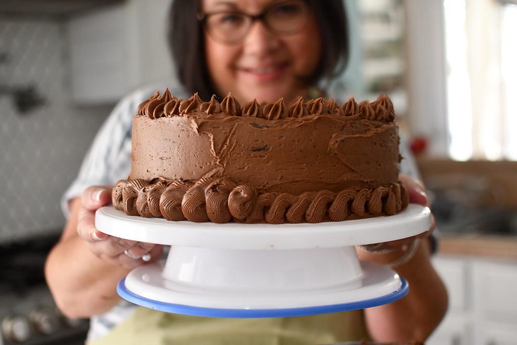 woman holding chocolate cake
