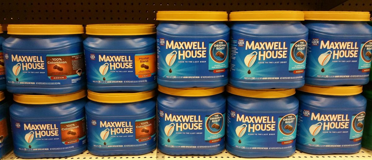 canisters of Maxwell House ground coffee on a store shelf