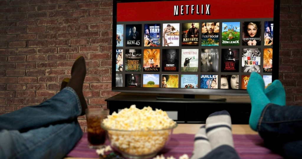 people watching netflix while eating popcorn
