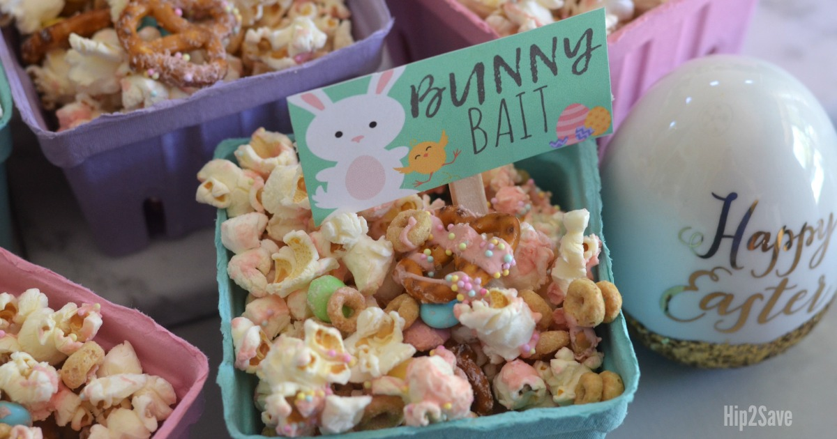 bunny bait easter popcorn snack in serving baskets with signs