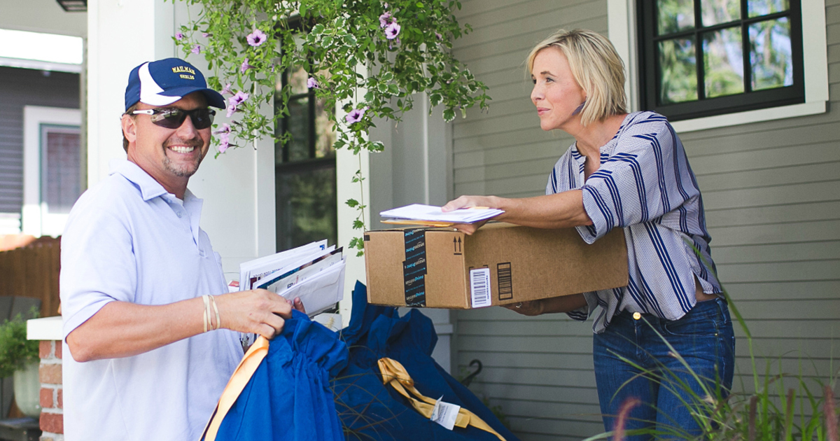 postal worker delivering mail to Collin