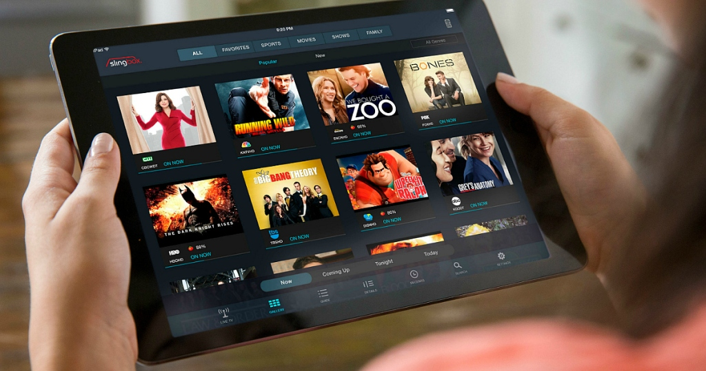 person watching Sling TV on tablet