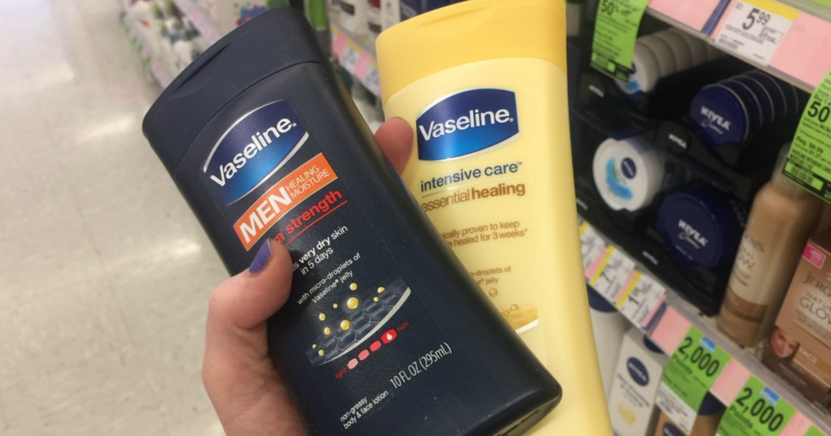Hand holding Vaseline Lotions