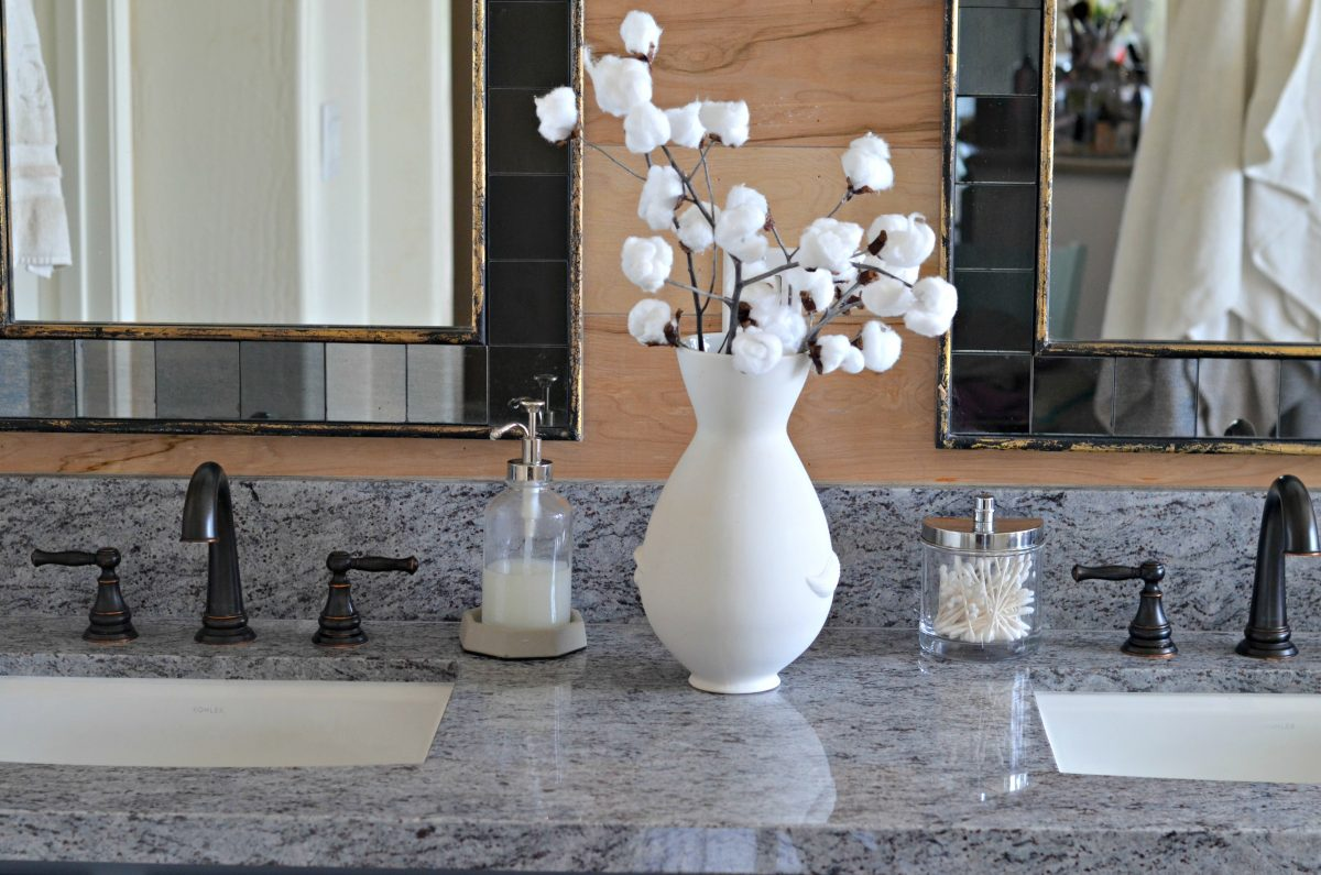 Home Decor DIY cotton stem branches in a vase on a bathroom vanity counter