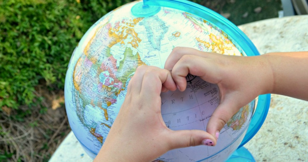 making heart over globe of the earth