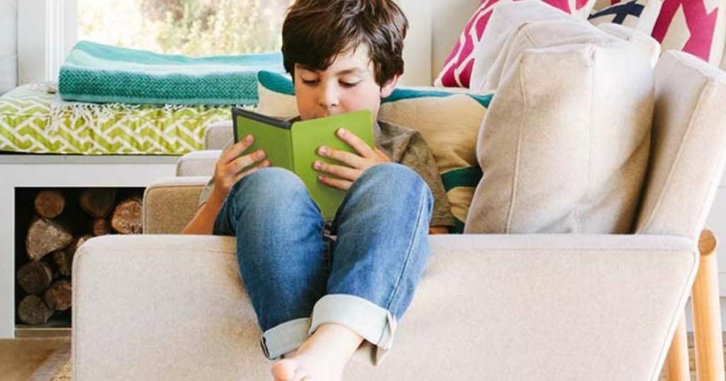 boy reading on a kindle