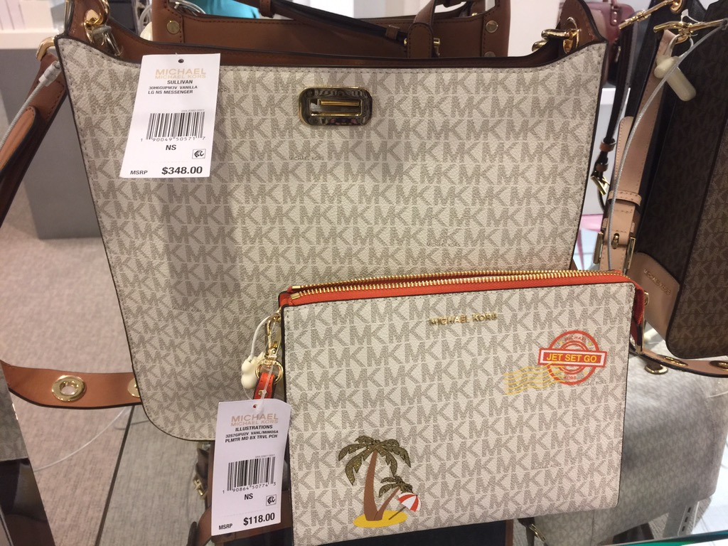 a40ef2a6a7db ... find the exact same purses on the shelves (with no luck) but I found  very similar Michael Kors logo handbags (pictured below) selling for almost  $350!