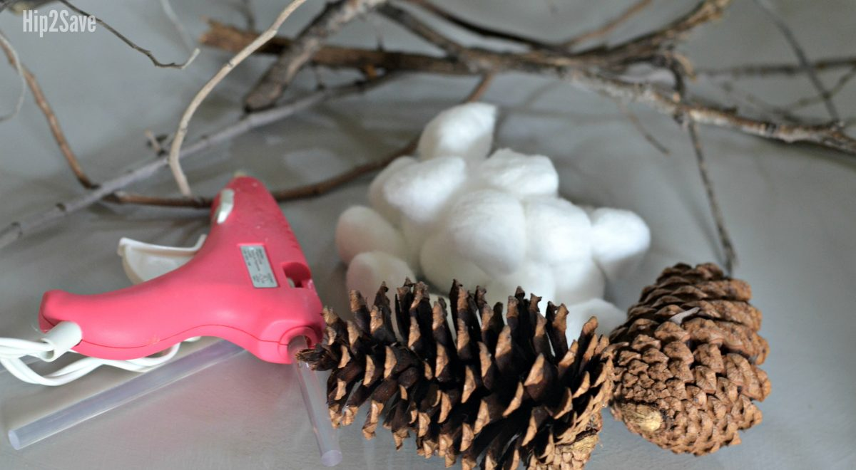 cotton stems, glue gun, and pinecones