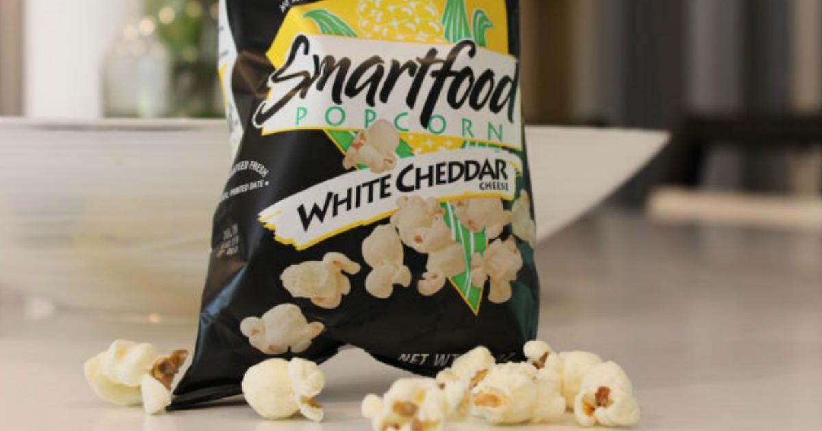 Smartfood Popcorn bag with spilled popcorn on counter