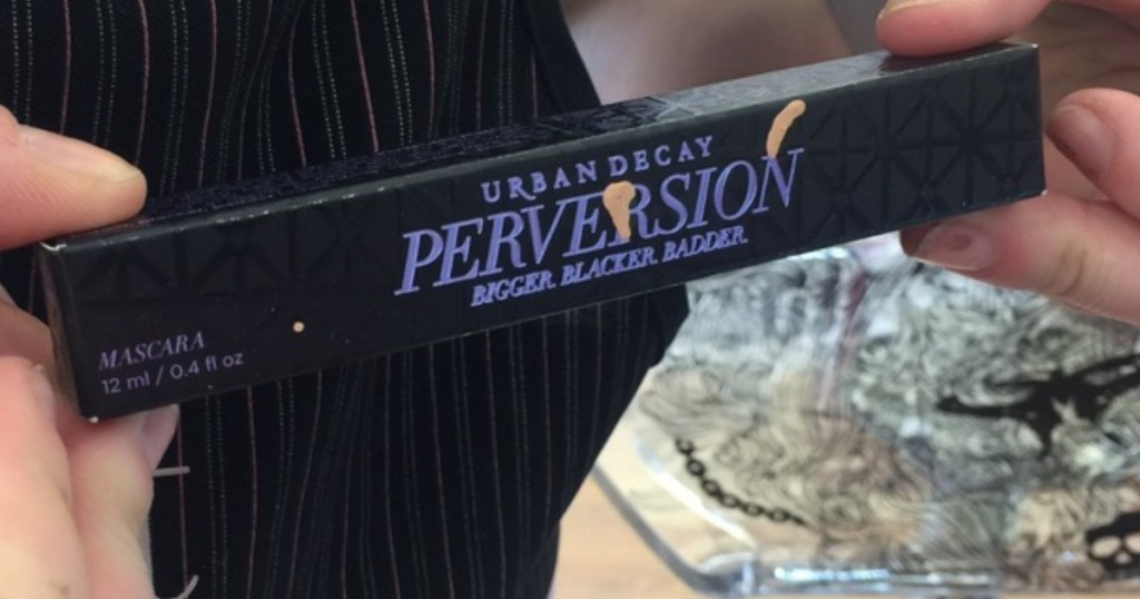 woman holding up a tube of perversion mascara