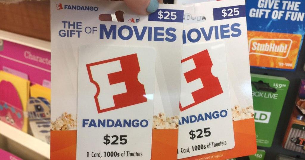 hand holding fandango movie gift cards