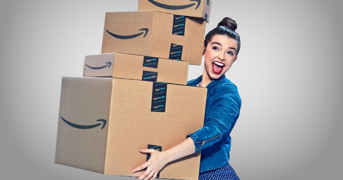 student holding stack of Amazon prime boxes
