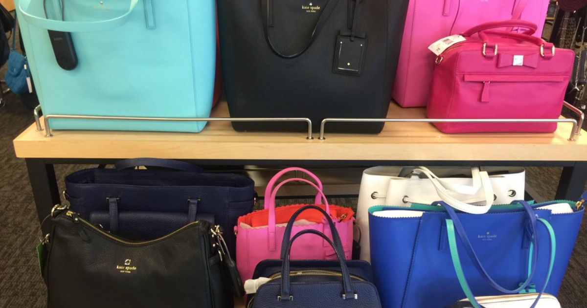 Kate Spade purses on a shelf in the store