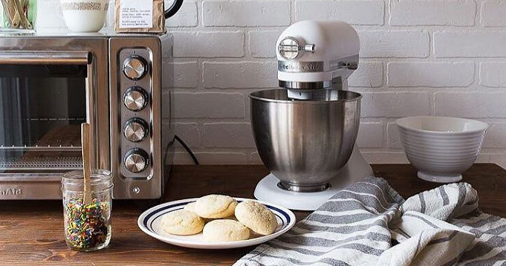 kitchenaid air fryer convection oven with white mixer on counter with sugar cookies