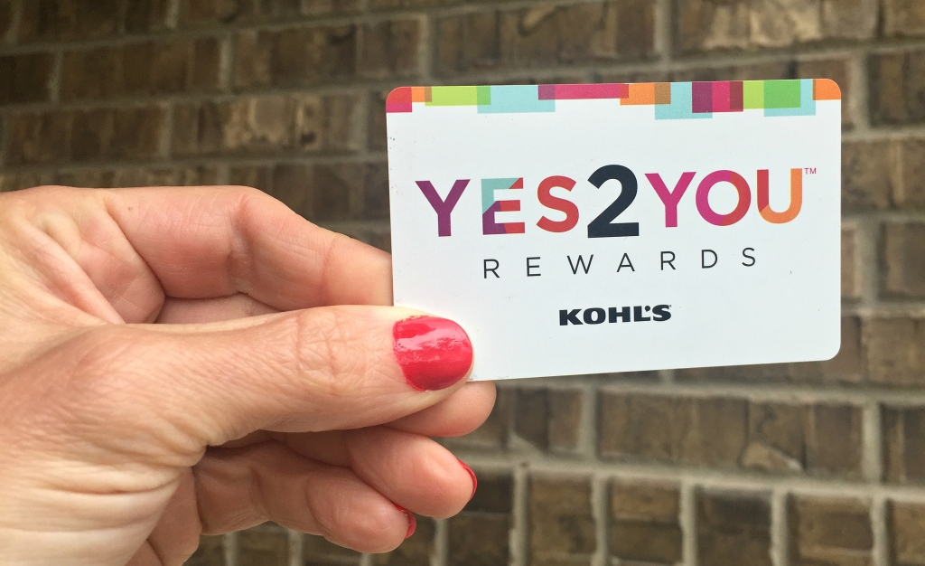 Woman holding Kohl's Yes2You card
