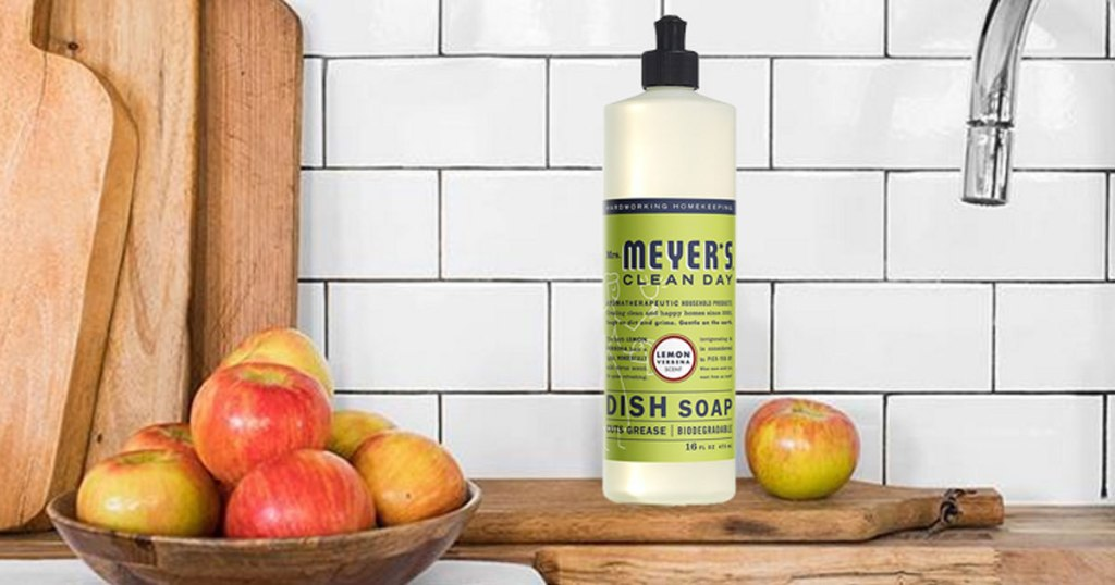 bottle of mrs meyers dish soap on kitchen counter near apples