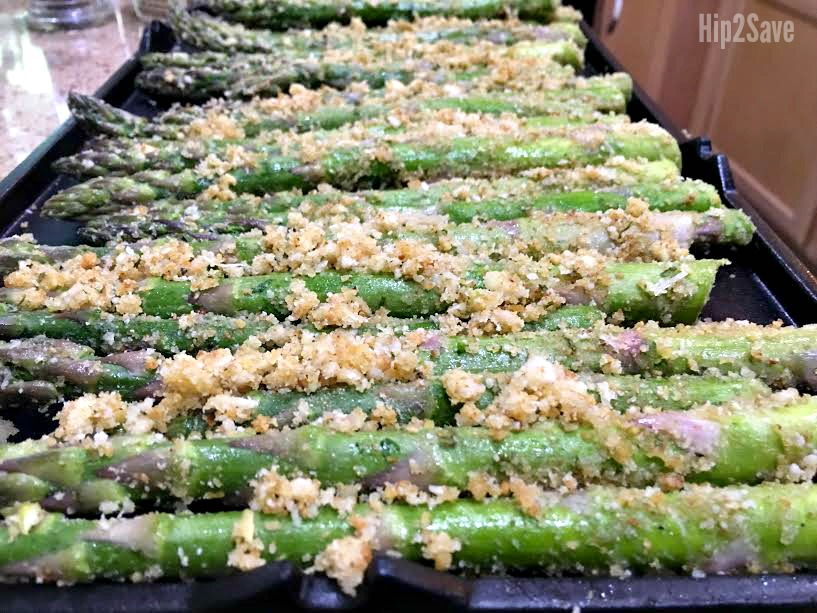 arranging the roasted asparagus on a tray for grilling
