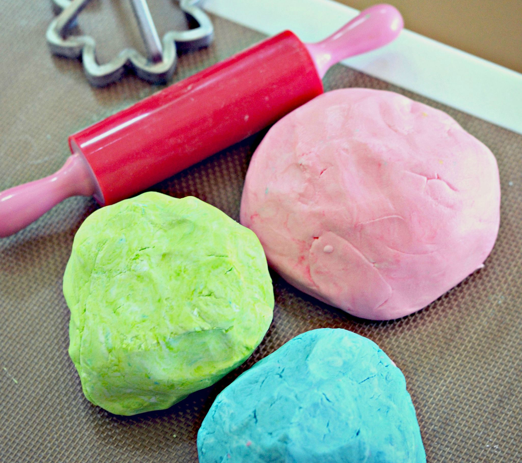 play doh in pink, blue, and green