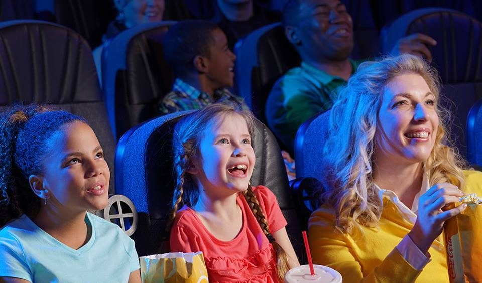 discounted kids summer movie offers – people enjoying a movie