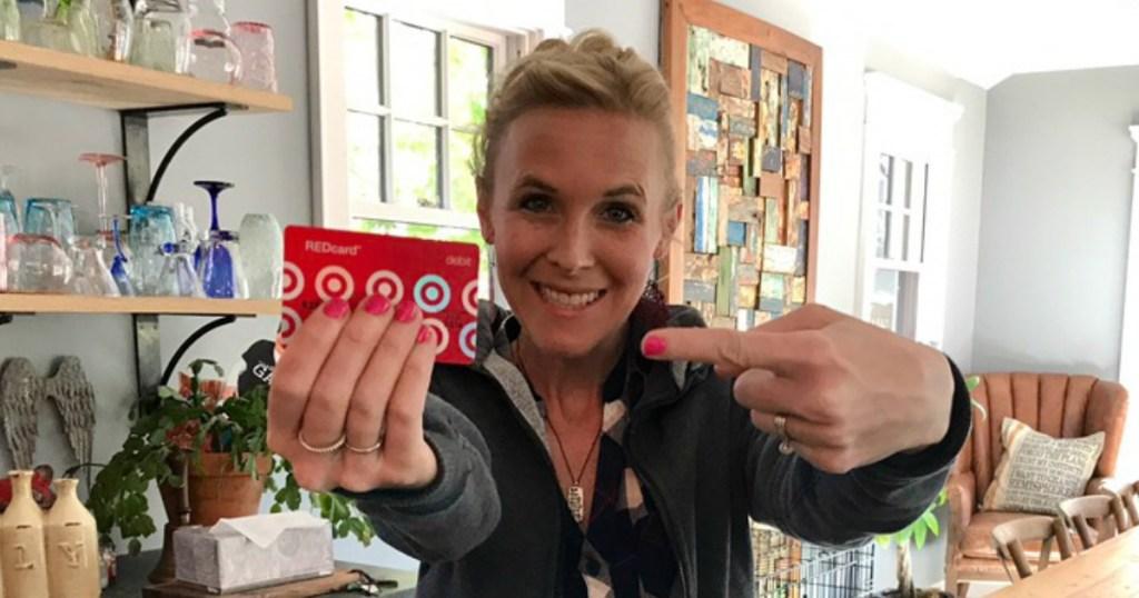 woman holding a Target debit card