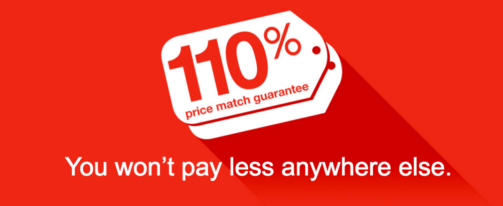 red sign featuring 110% staples guarantee