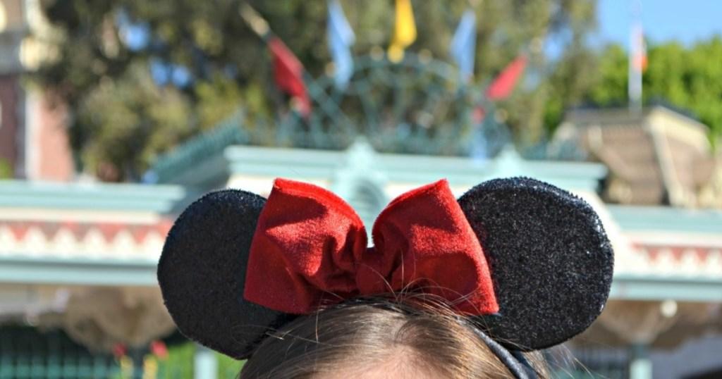 girl wearing Minnie Mouse ears headband at Disney World
