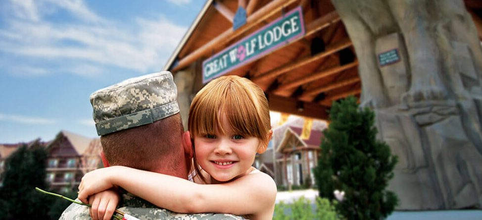 13 tips for your great wolf lodge vacation | girl hugging man in service uniform