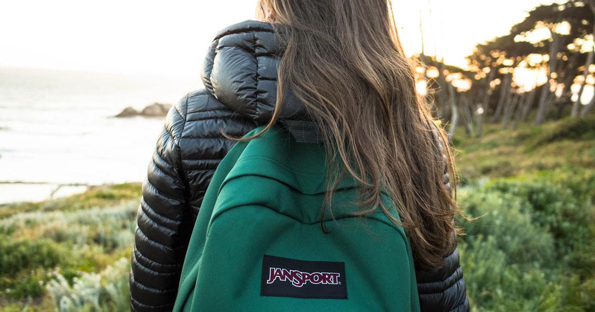 girl wearing jansport backpack