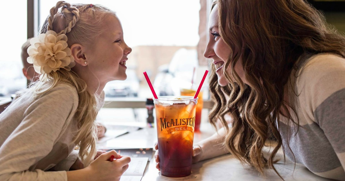 mcalisters deli young girl and lady smiling at each other