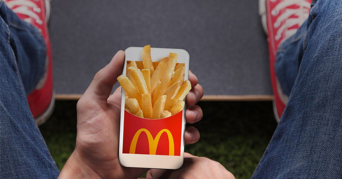 McDonald's app - with french fries popping out of the phone