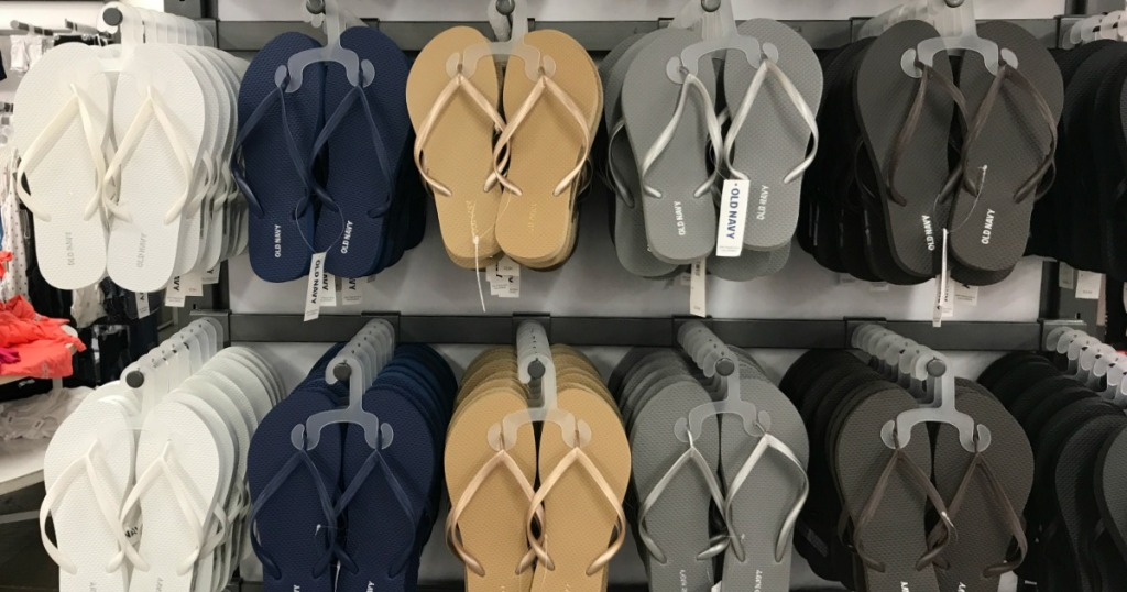 white, navy, gold, and silver flip flops on display at old navy