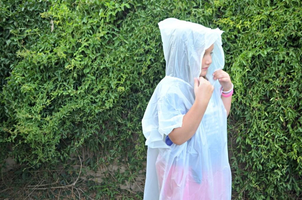 young girl wearing rain poncho