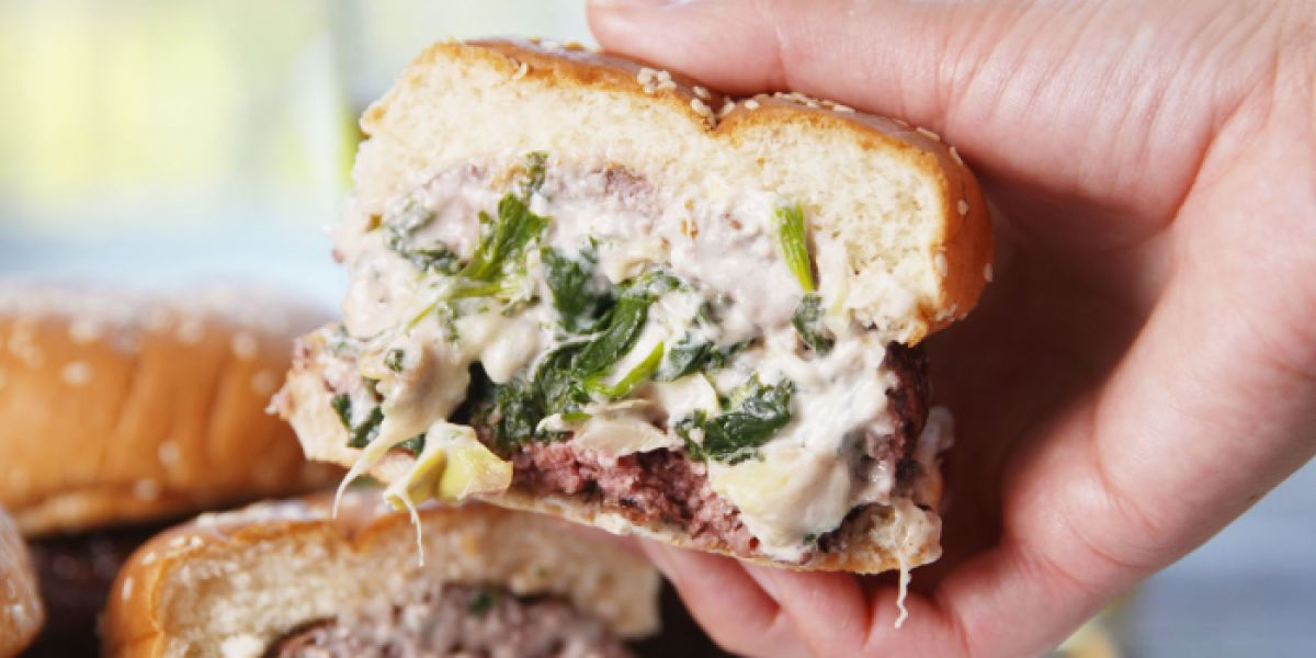 burger topped with spinach & artichoke dip
