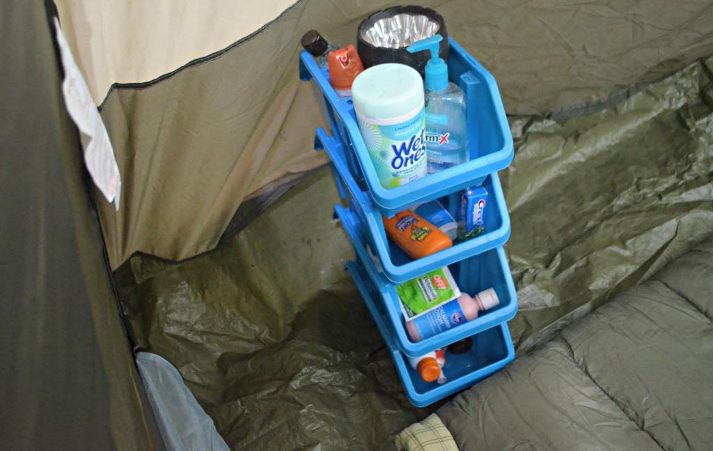 camping hacks - stacking organization bins in tent