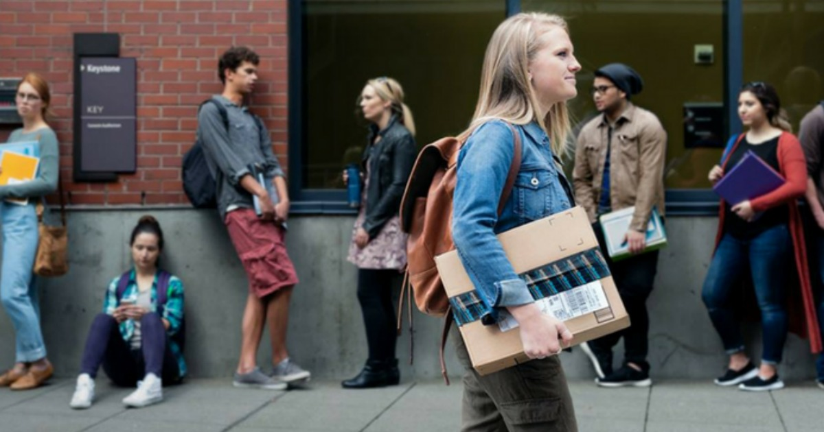 college students get a free amazon prime student trial - woman carrying an amazon box