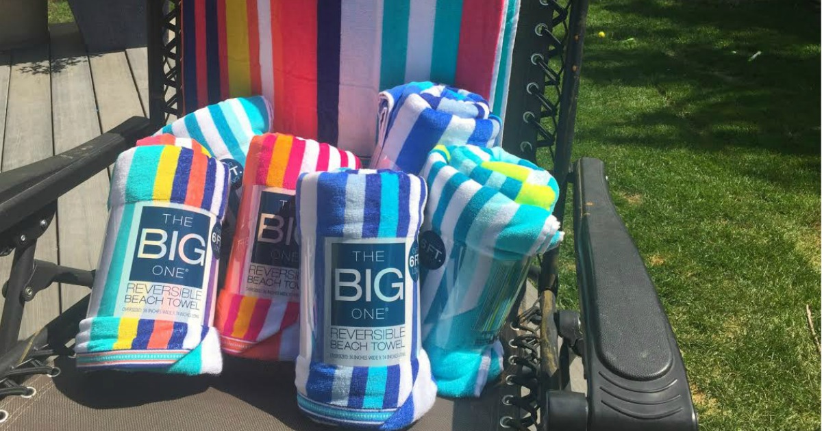 The Big One Beach Towels on a beach chair outside
