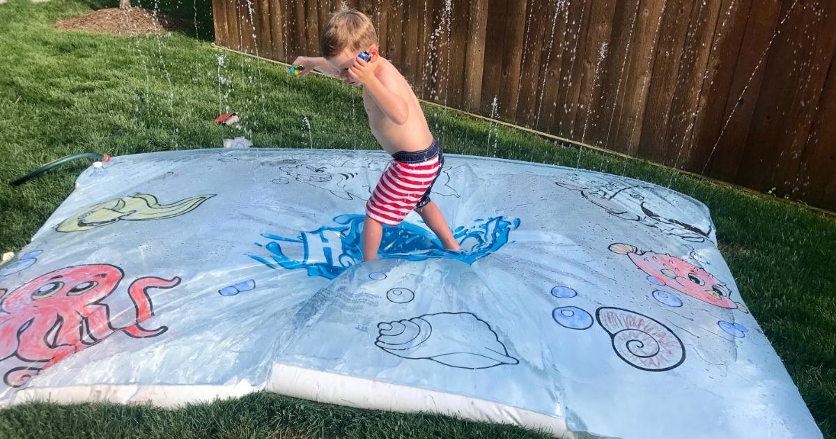 kid walking on fun water blob mat